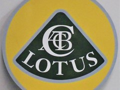 Navigate to A Lotus garage wall sign.