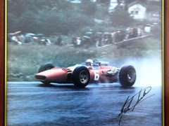 Navigate to A signed John Surtees print.