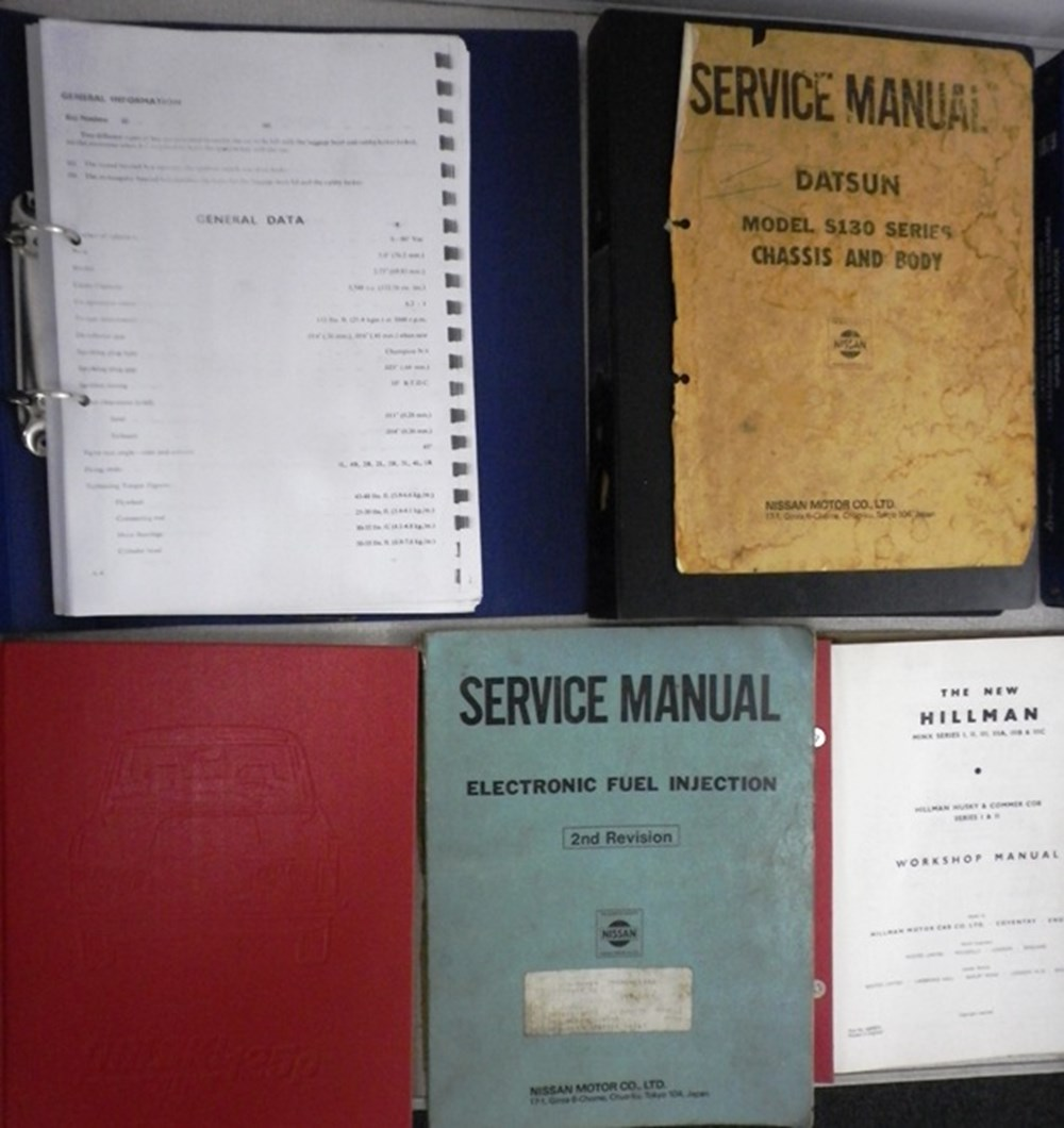 Lot 84 - A selection of vehicle manuals and books