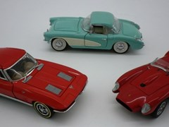 Navigate to Three model cars