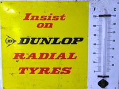 Navigate to Dunlop tyres sign.