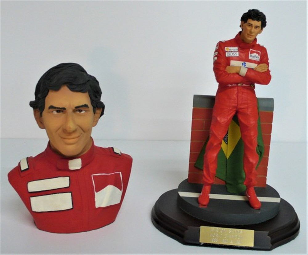 Lot 027 - Motor racing figures.