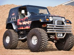 Navigate to Lot 232 - 1997 Jeep Wrangler TJ Custom Monster Truck