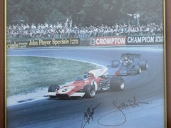 Navigate to A signed Fittipaldi and Ickx print.