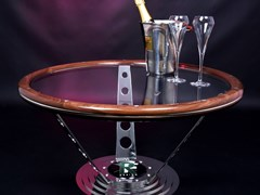 Navigate to A steering wheel design coffee table.