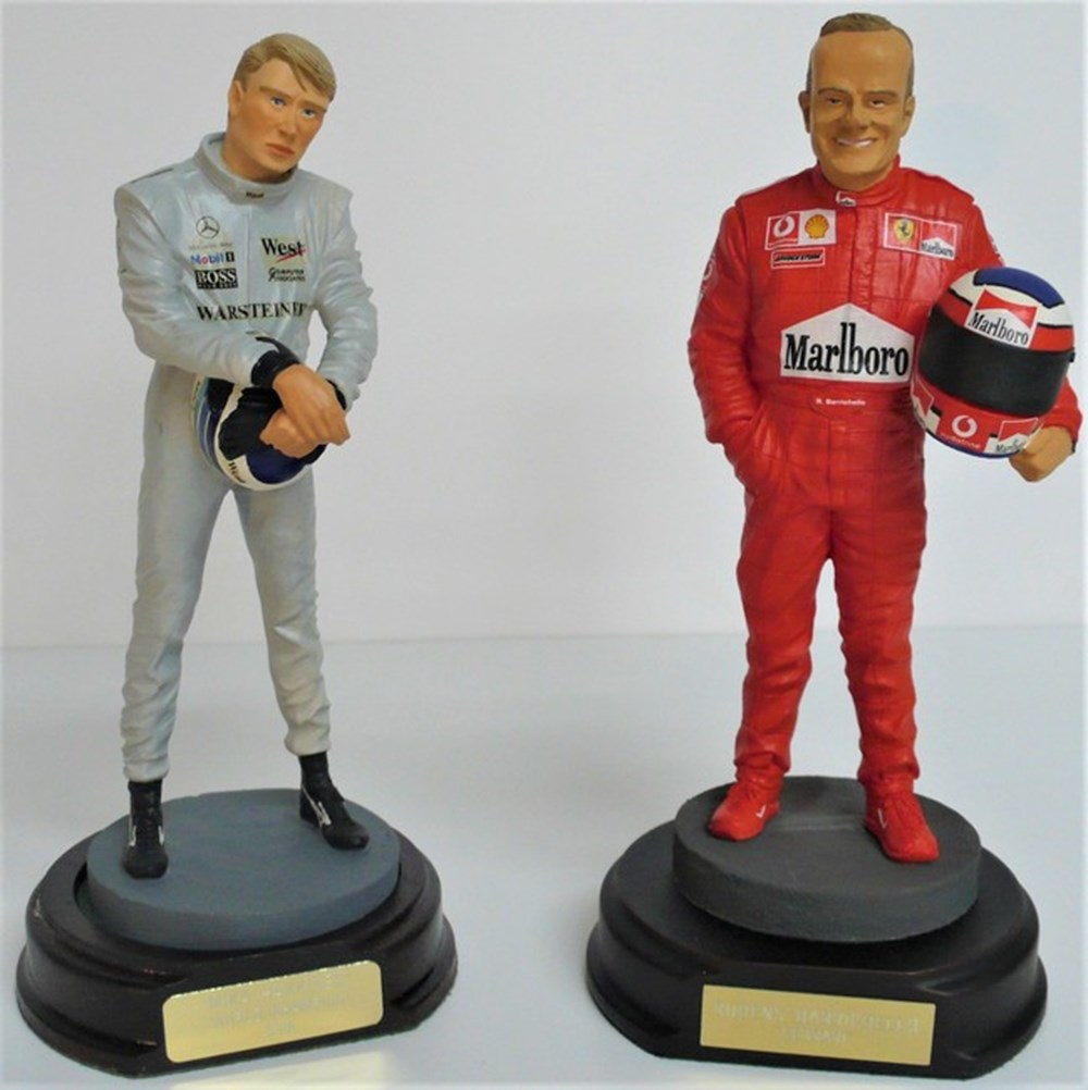 Lot 026 - Motor racing figures.