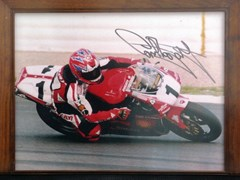 Navigate to A signed Carl Fogarty print and model.