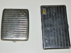 Navigate to Two cigarette cases.