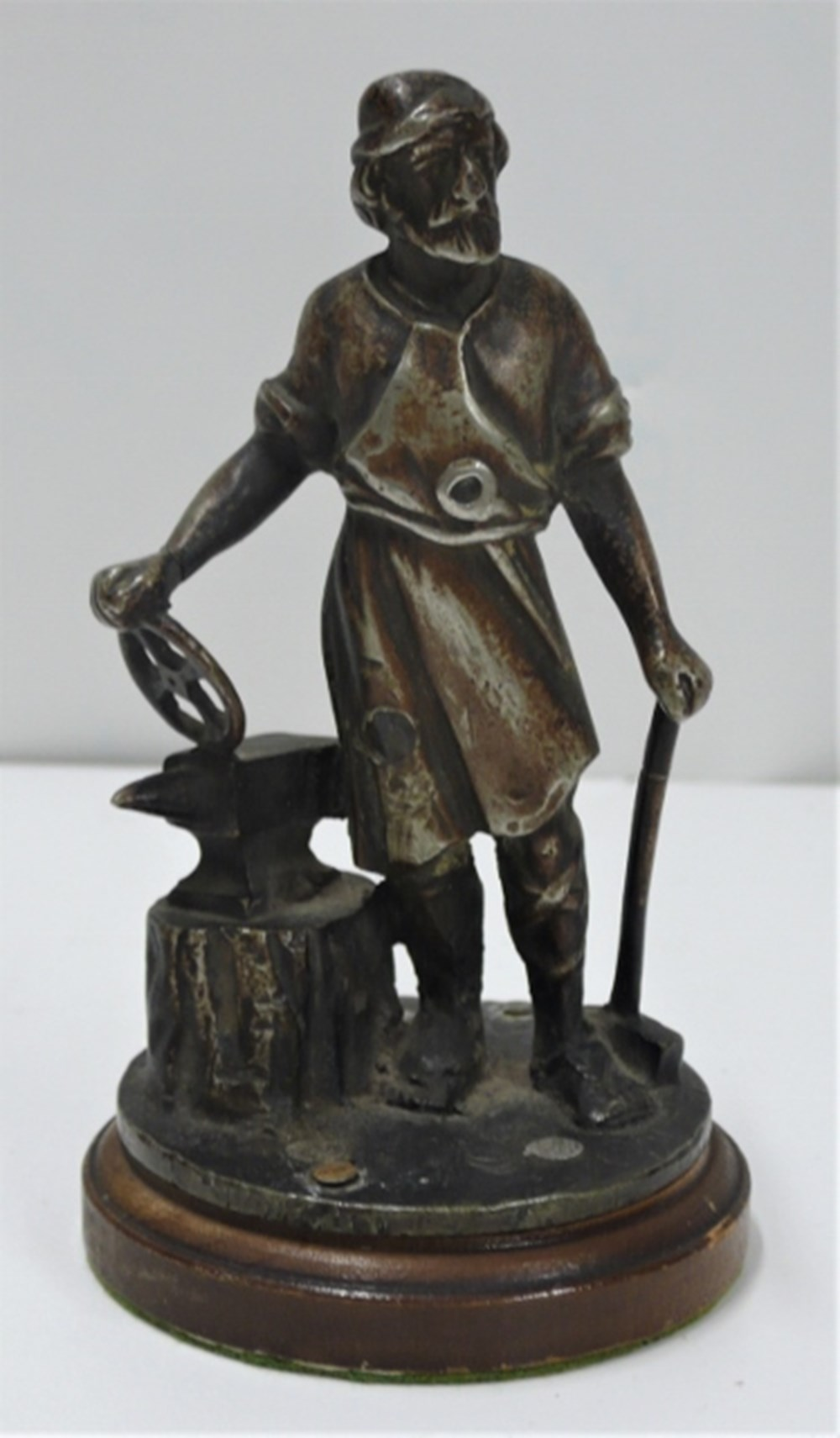 Lot 72 - Vulcan blacksmith mascot.