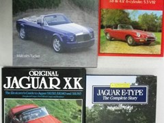 Navigate to Four motoring books including.