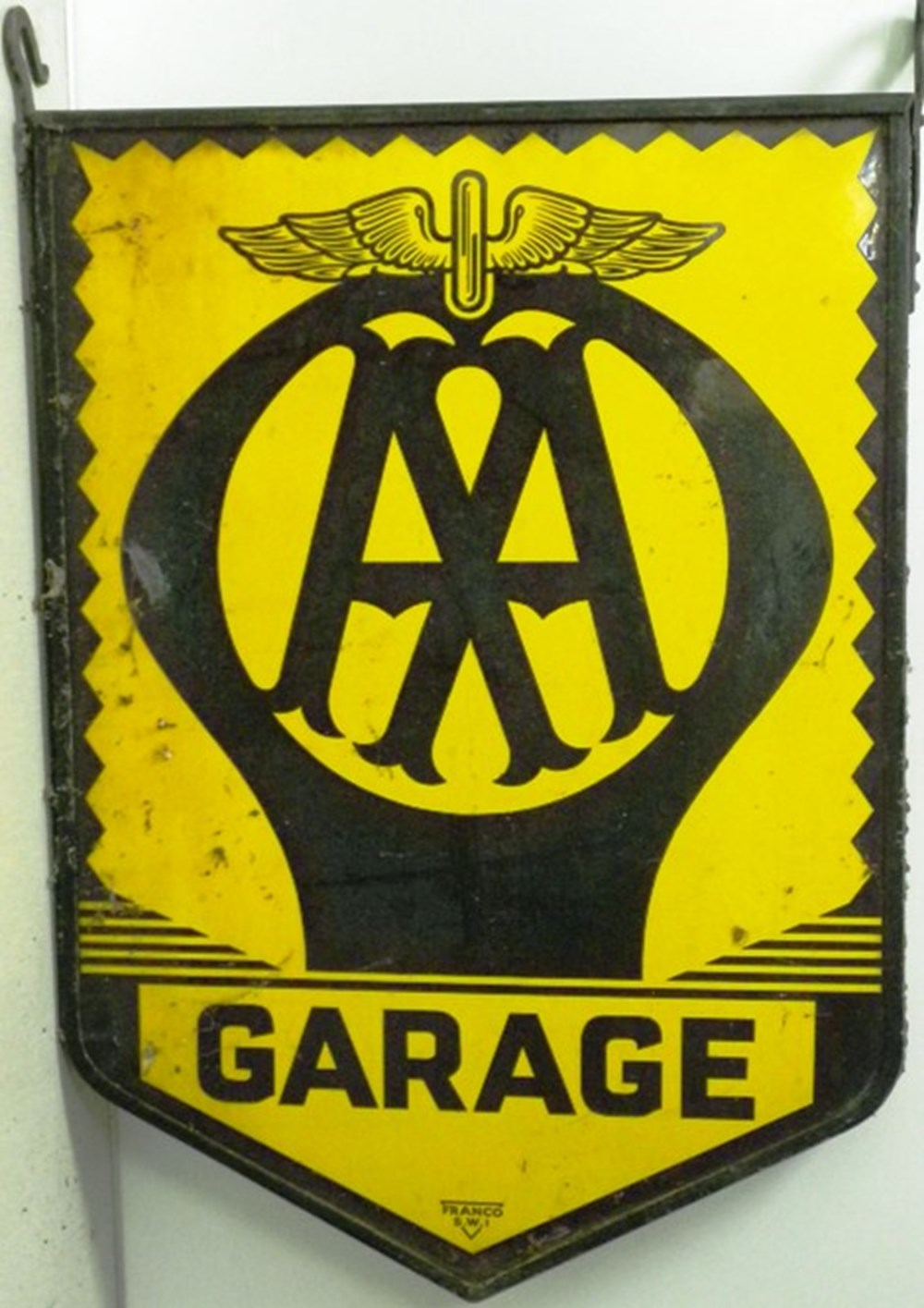 Lot 61 - An AA hanging sign.