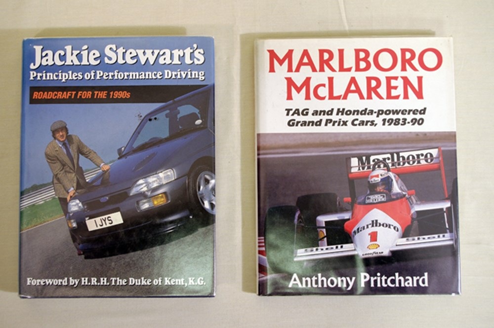 Lot 100 - Signed motoring books