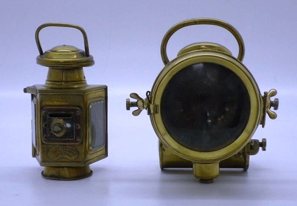 Lot 19 - Two early brass oil lamps.