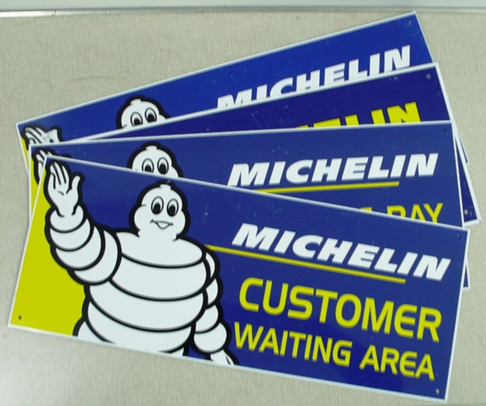 Lot 001 - Four aluminium Michelin tyre signs