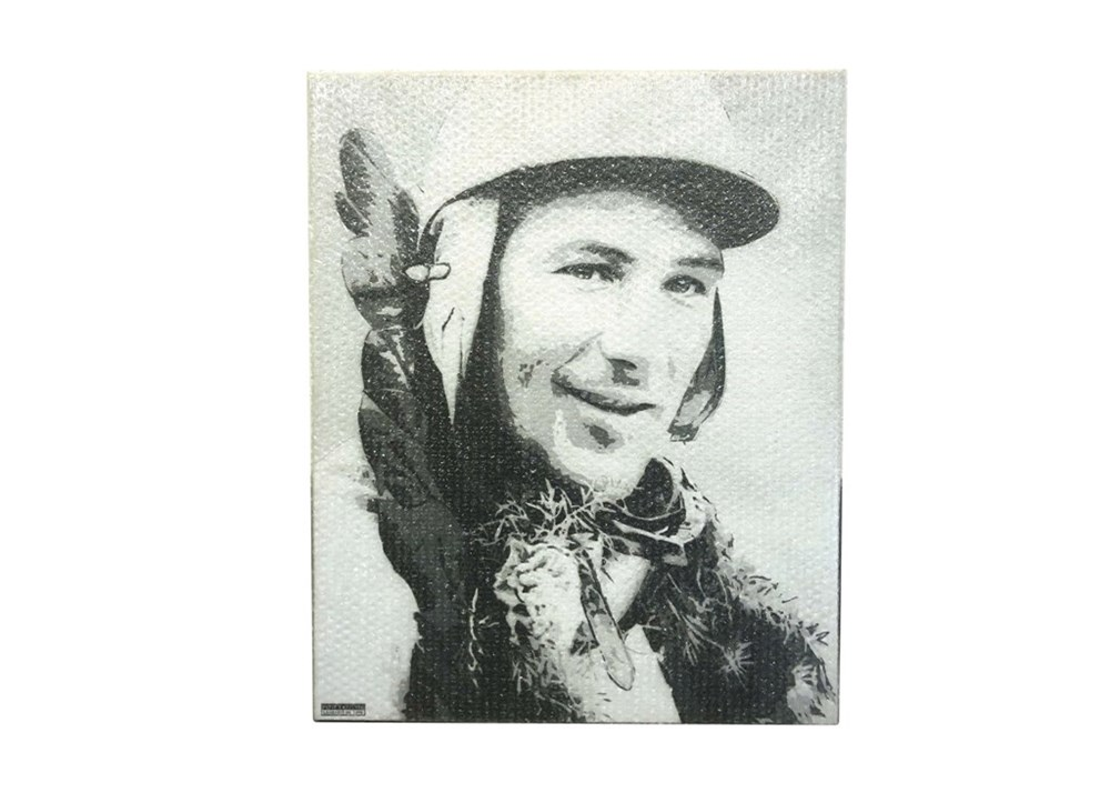 Lot 108 - A canvas print of the late Sir Stirling Moss *WITHDRAWN*
