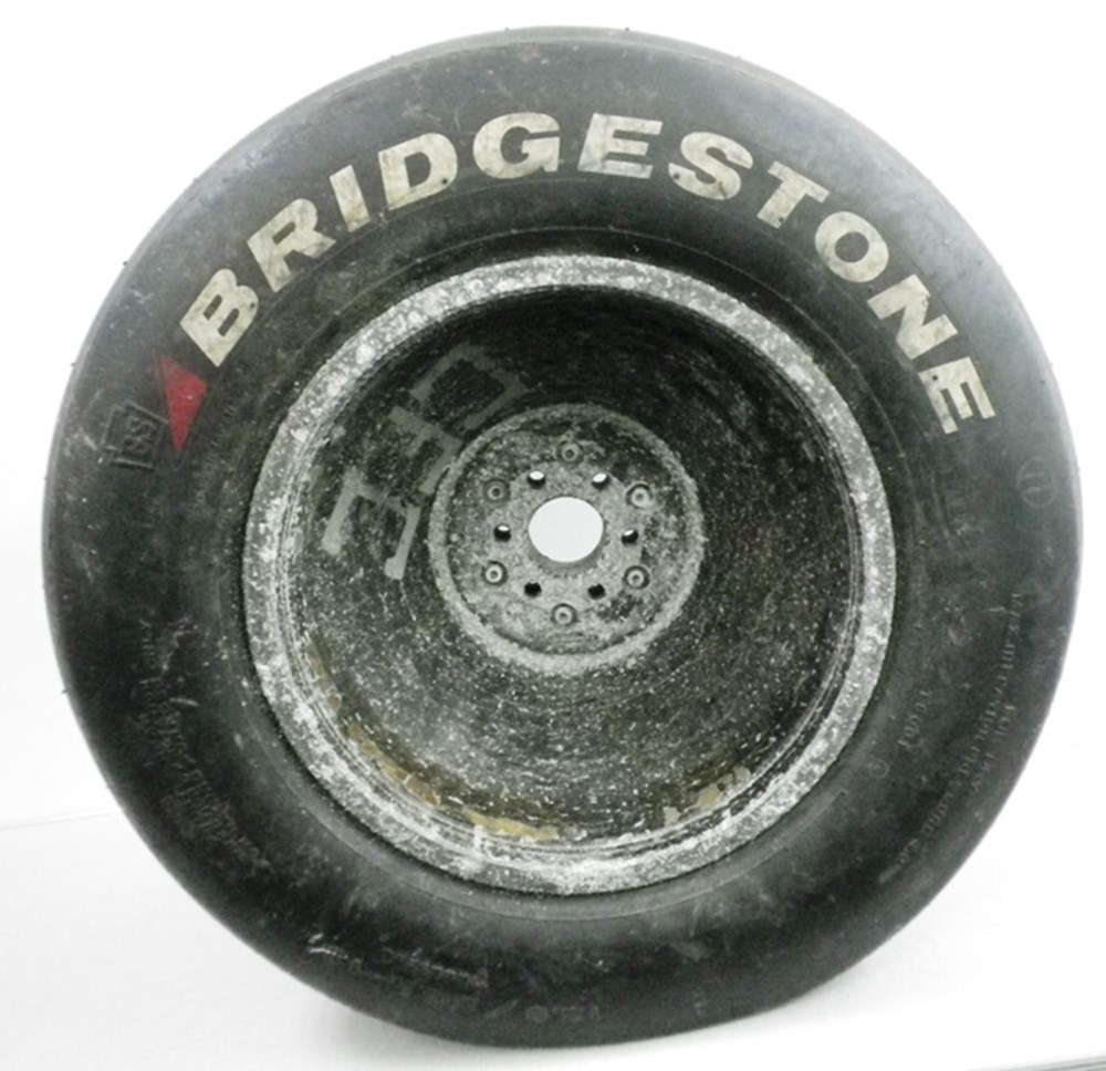 Lot 26 - rear F1 wheel and tyre