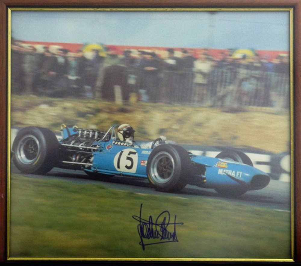Lot 28 - A signed Jackie Stewart print.