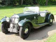 Navigate to Lot 239 - 1938 Morgan 4-4