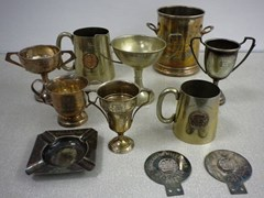 Navigate to A selection of winner's cups and medals