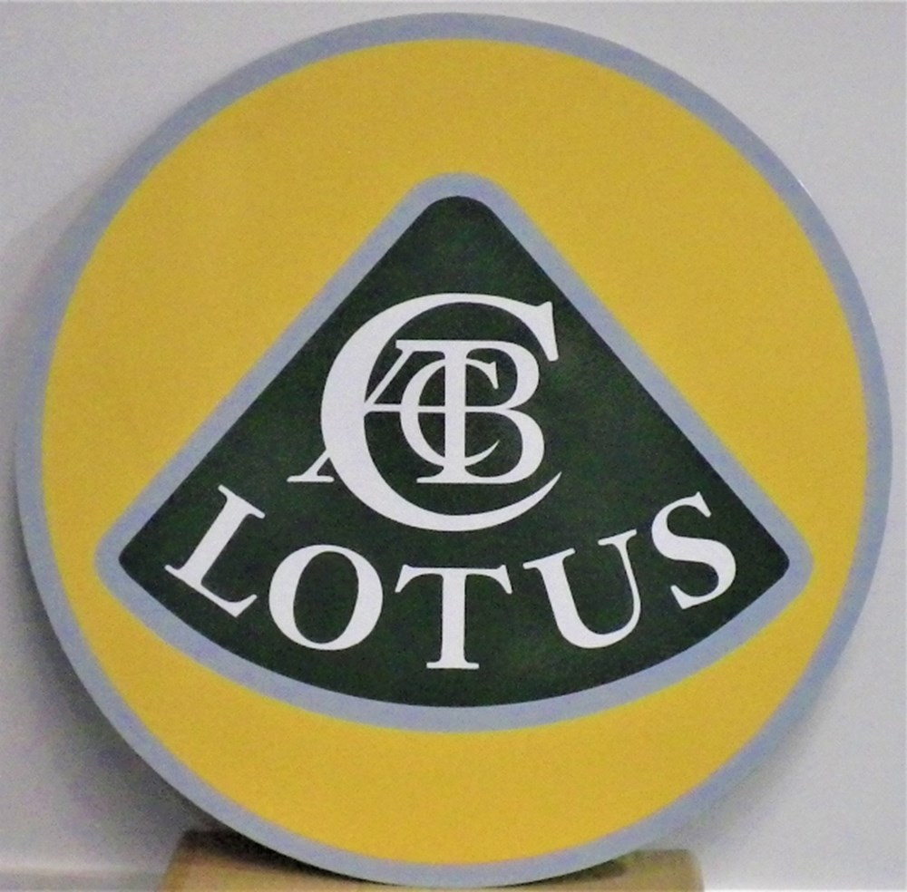 Lot 57 - A Lotus garage wall sign.
