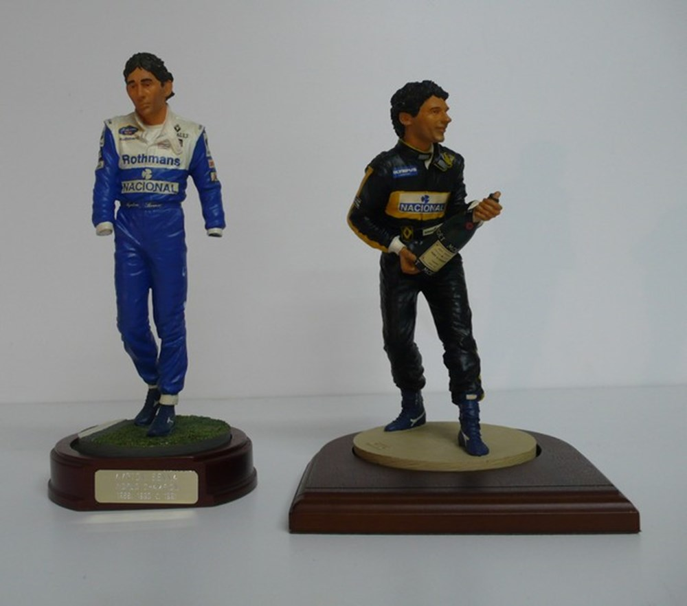Lot 090 - Motor racing figures.