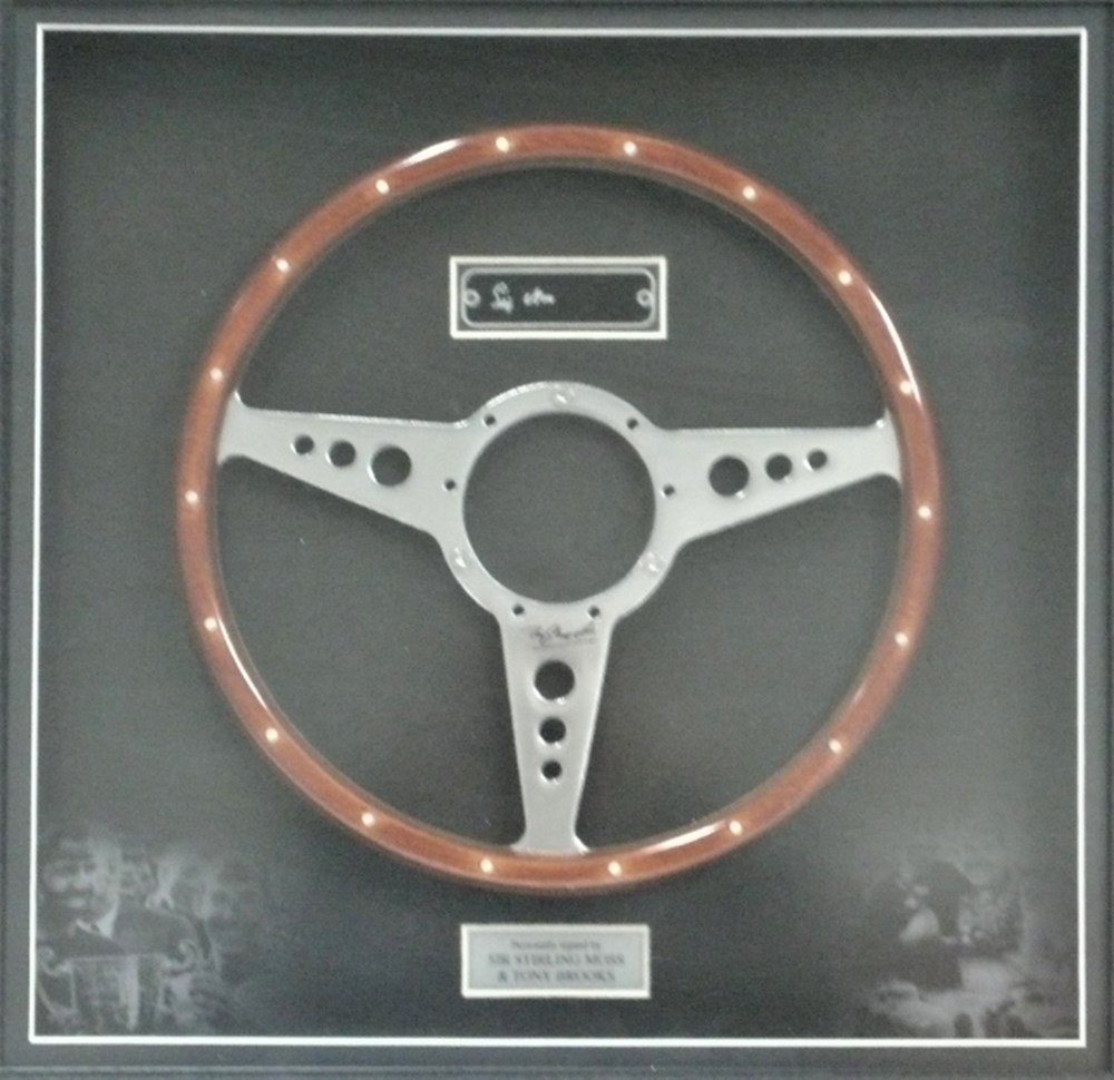 Lot 76 - A signed steering wheel.