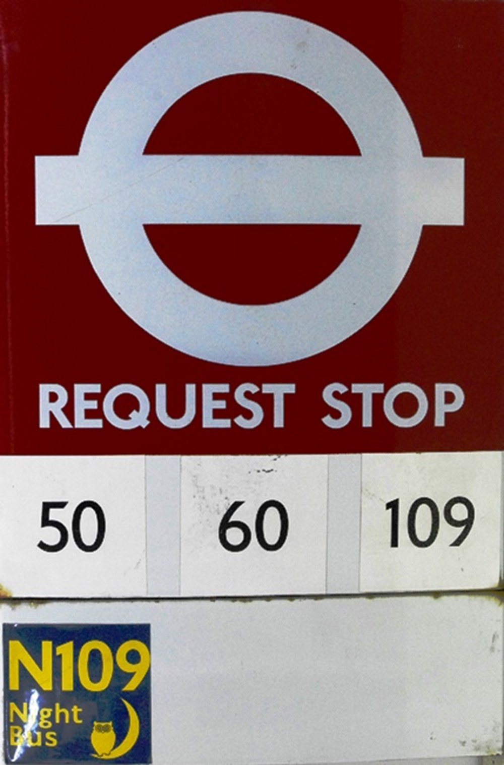 Lot 1 - A bus stop sign