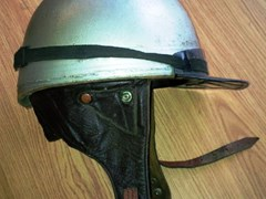Navigate to Two early crash helmets
