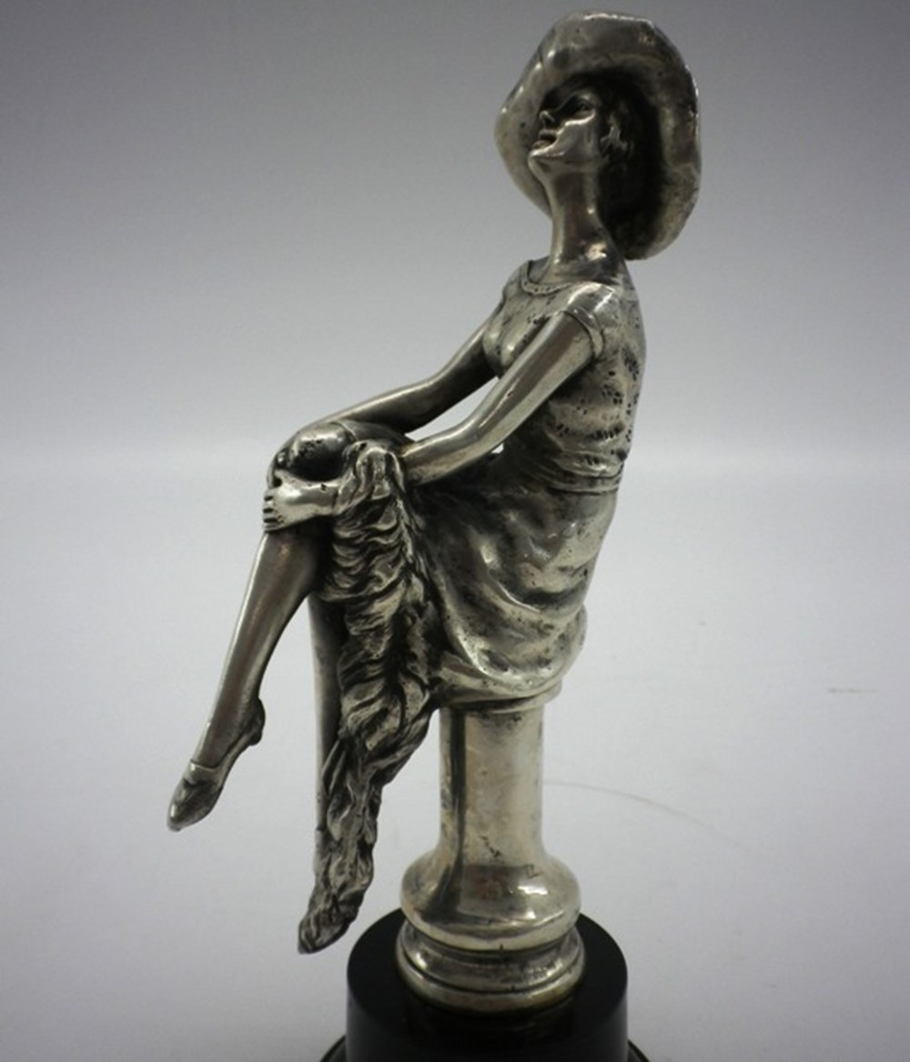 Lot 88 - Seated girl mascot