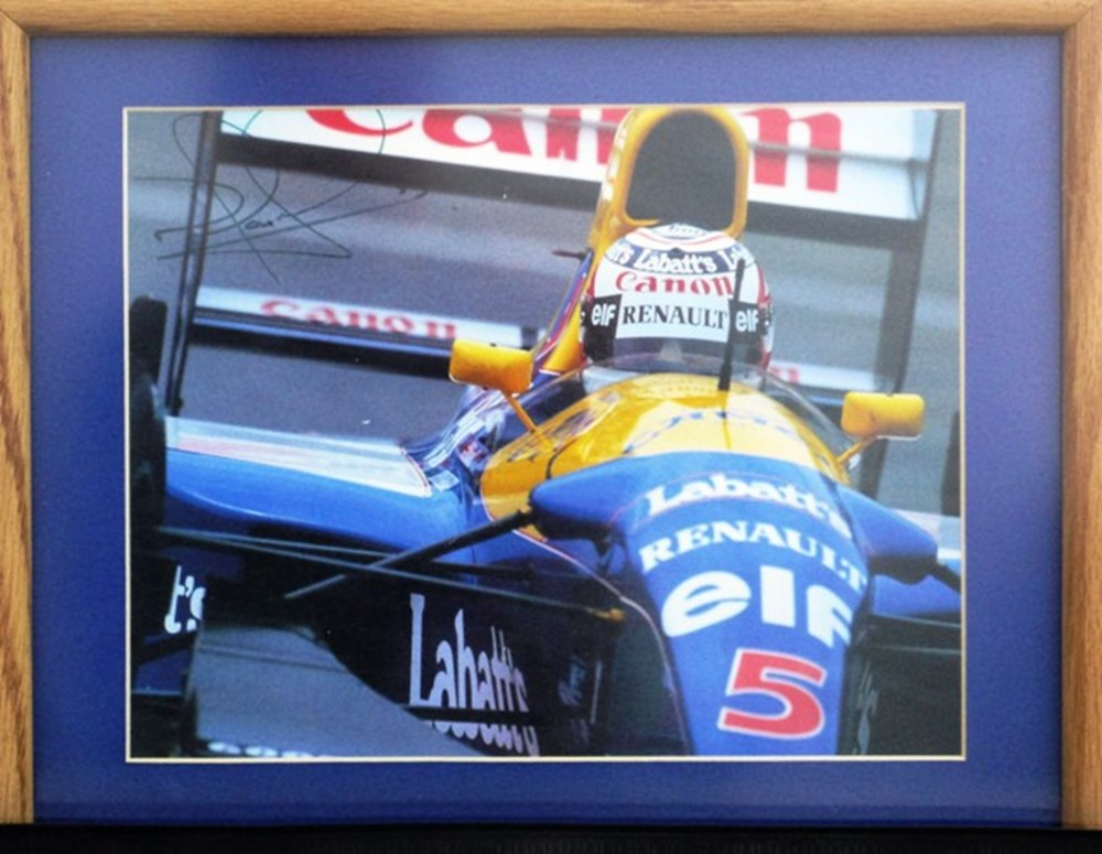 Lot 56 - A signed Nigel Mansell print.