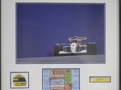 Navigate to Ayrton Senna signed presentation.
