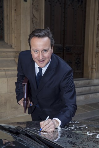 David Cameron signs 'Write off World' BMW