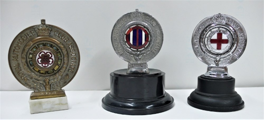 Lot 30 - Three motoring badges.