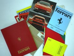 Navigate to A collection of brochures and motoring paperwork