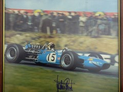 Navigate to A signed Jackie Stewart print.