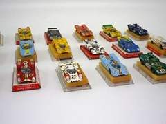 Navigate to 18 die-cast model competition cars