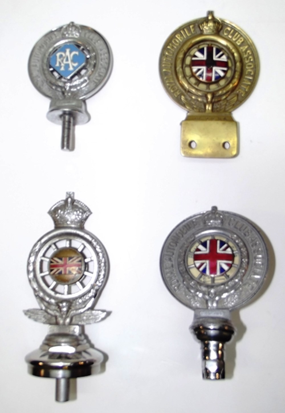 Lot 023 - Four early RAC badges