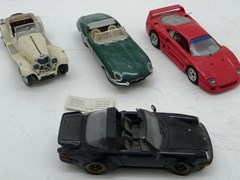 Navigate to Four Franklin Mint model cars