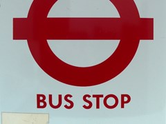 Navigate to London Transport bus stop sign