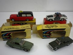 Navigate to Four die-cast model cars