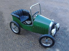 Navigate to A green roadster child's pedal car